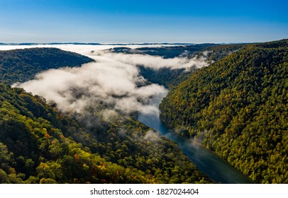 Aerial drone image of the Cheat River flowing through narrow wooded gorge in the autumn towards Cheat Lake near Morgantown, WV