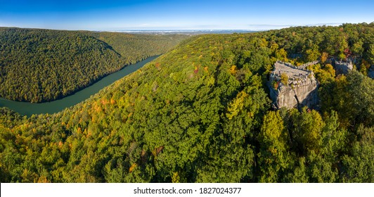 Aerial drone image of the Coopers Rock state park overlook over the Cheat River in narrow wooded gorge in the autumn towards Cheat Lake Morgantown, WV