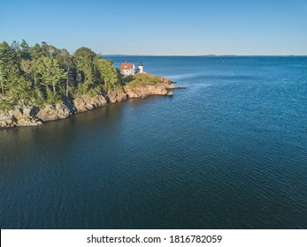 Aerial Drone image of the Curtis Island Lighthouse att he entrance to Camden Harbor on Penobscot Bay in Maine on a late afternoon