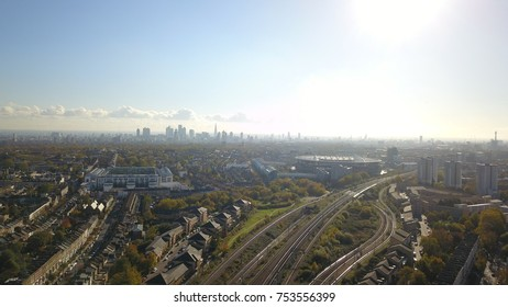 Aerial drone image of Emirates Arsenal Stadium and the london skyline.
