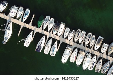 Aerial drone image of a marina populated with recreational boats and yachts in Yvoire, France on Lake Geneva (Leman).