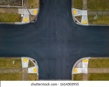 Aerial drone image of a road intersection looking straight down without vehicles