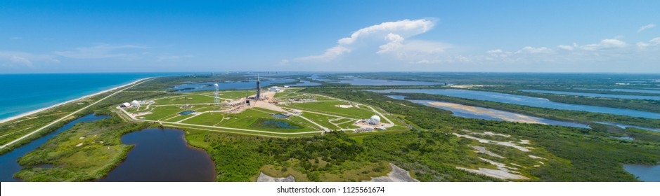 Aerial drone image of a rocket launch platform with nature landscape