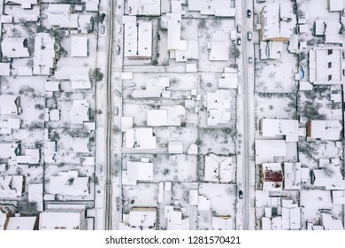 aerial drone image of the roof of a suburban houses during winter