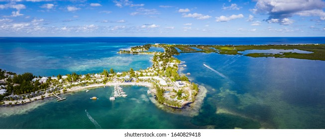 aerial drone image of seven mile beach, west bay and george town on the island of grand cayman in the cayman islands in the clear blue and green tropical waters of the caribbean sea