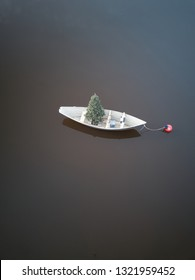 Aerial drone image of a solar battery powered christmas tree in a skiff on the waterway in Kennebunkport Maine