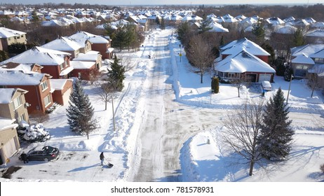 Aerial drone image of suburban houses after a snow storm during Christmas in Oakville, Ontario.