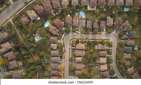 Aerial drone image of a suburban neighborhood during fall.