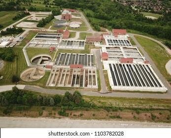 Aerial drone image, Top down, of a water reclamation plant (sewage treatment) with bioreactors and filtration pools.
