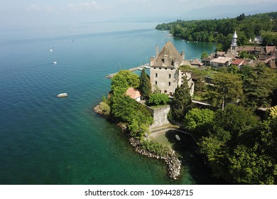 Aerial drone image of Yvoire medieval town and its defensive castle overlooking the Geneva Lake.
