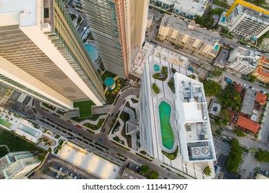 Aerial drone inspection of a rooftop pool city highrise tower
