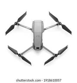 Aerial Drone Isolated on White Background. Top View of Quad Copter with Digital Camera. Flying Remote Control Air Drone. Headless Quadcopter with 4K Hasselblad Camera and Remote Control
