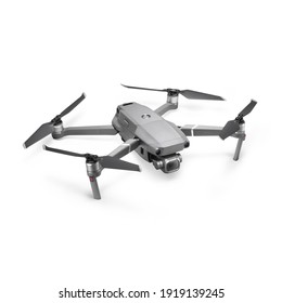 Aerial Drone Isolated on White Background. Top Side Front View Quad Copter with Digital Camera. Flying Remote Control Air Drone. Headless Quadcopter with 4K Hasselblad Camera and Remote Control