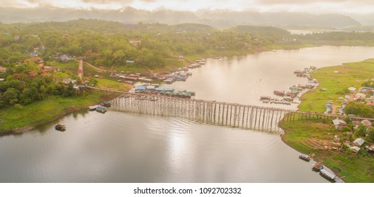 Aerial drone morning shot in Sangkhlaburi District, Kanchanaburi, Thailand. The Mon wooden bridge, The longest wooden bridge in Thailand