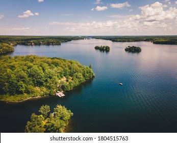 Aerial drone of Muskoka lake daytime