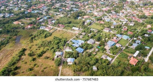 aerial from drone: neighborhood with residential houses and driveways, land use planning concept