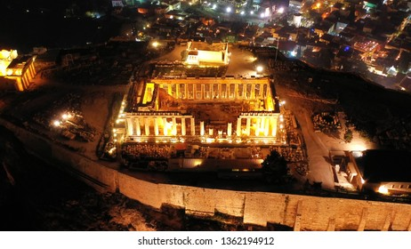 Aerial drone night panoramic shot of iconic illuminated landmark Acropolis hill and the Masterpiece of Ancient times and Western civilisation - the Parthenon, Athens, Attica, Greece