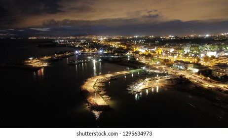 Aerial drone night shot of famous port of Glyfada area at dusk, Attica, Athens riviera, Greece