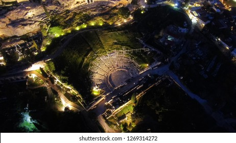 Aerial drone night shot of iconic Theatre of Dionysus in the slopes of Acropolis hill, Athens historic centre, Attica, Greece