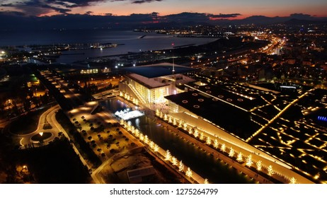 Aerial drone night shot of iconic public settlement of illuminated Stavros Niarchos Foundation and cultural centre during Christmas time, Faliro, Attica, Greece