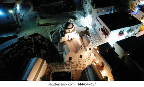 Aerial drone night shot of iconic chapel of Paraportiani next to famous and picturesque Litlle Venice, Mykonos island, Cyclades, Greece