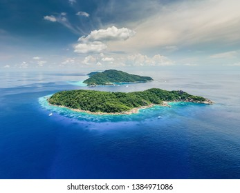 Aerial drone panorama of beautiful tropical islands in a clear blue ocean (Similan Islands)