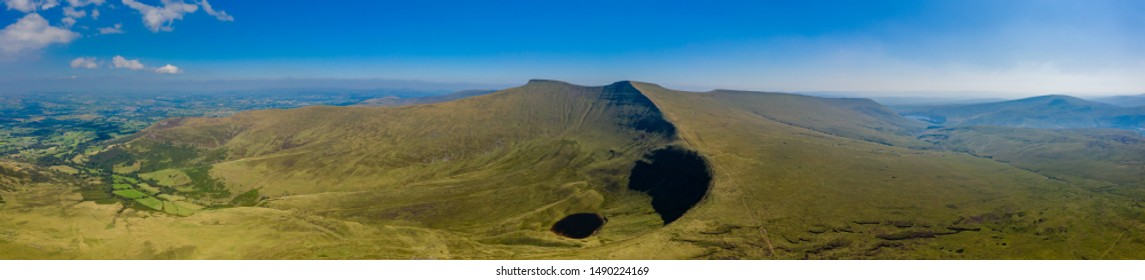 Aerial drone panorama of Corn Du and Pen-y-Fan mountains in the Brecon Beacons, South Wales, UK