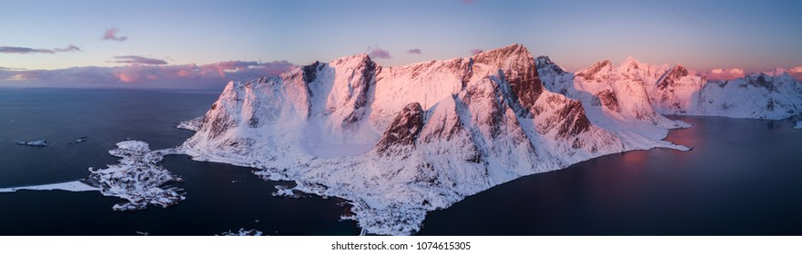 Aerial drone panorama photo - Beautiful sunrise over the mountains of the Lofoten Islands.  Reine, Norway