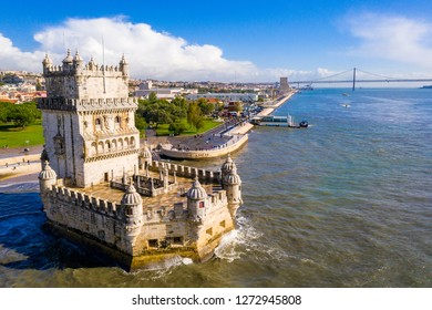 Aerial drone panorama photo of the Belem Tower (Belém Tower). A medieval castle fortification on the Tagus river of Lisbon Portugal