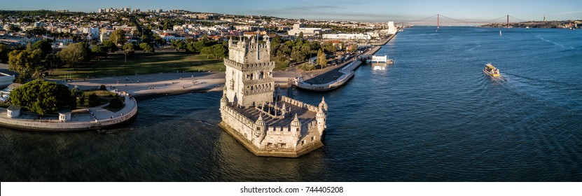 Aerial drone panorama photo of the  Belem Tower (Belém Tower) at sunset.  A medieval castle fortification on the Tagus river of Lisbon Portugal