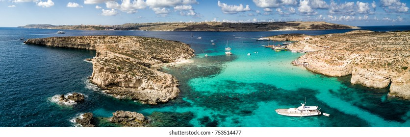 Aerial drone panorama photo - The famous Blue Lagoon in the Mediterranean Sea.  Comino Island, Malta.