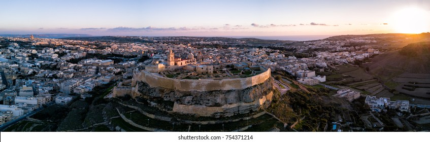 Aerial drone panorama photo - The Gozo Citadel at sunset.  A medieval fortress in the city of Victoria (Rabat).  Island of Gozo, Malta.