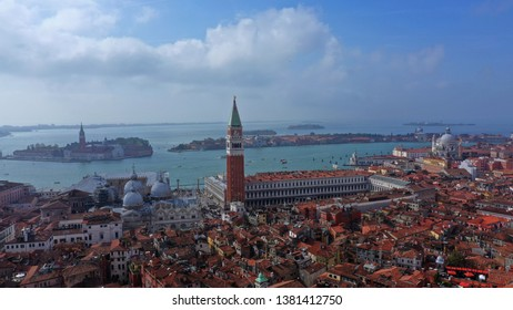 Aerial drone panoramic photo of iconic and unique Campanile in Saint Mark's square or Piazza San Marco, Venice, Italy