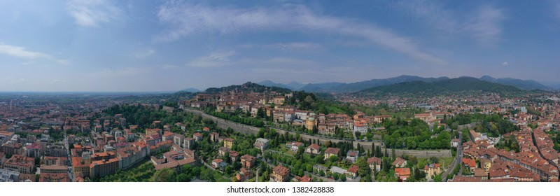 Aerial drone panoramic photo of iconic old fortified upper Medieval city of Bergamo, Lombardy, Italy