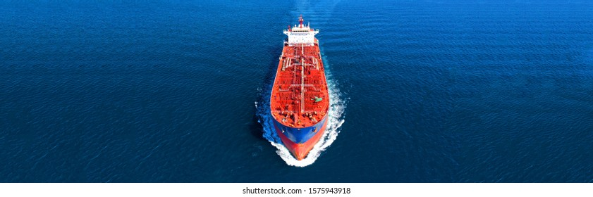Aerial drone panoramic photo of industrial crude oil and fuel tanker ship cruising deep blue open ocean sea