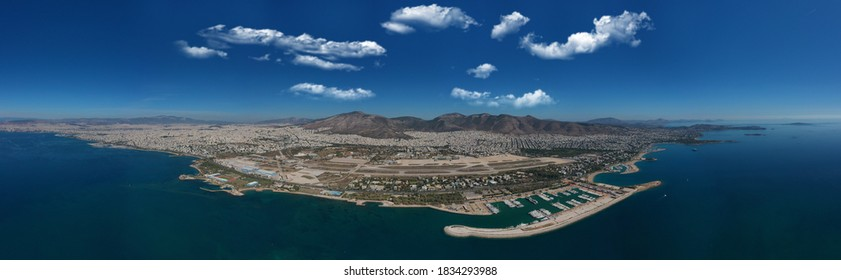 Aerial drone panoramic photo of Marina of Agios Kosmas and abandoned former international airport of Athens in Elliniko area, South Athens riviera, Attica, Greece