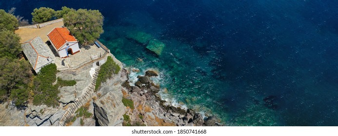 Aerial drone panoramic photo of picturesque chapel of Saint John built in famous cliff where Mamma Mia movie was filmed, Skopelos island, Sporades, Greece