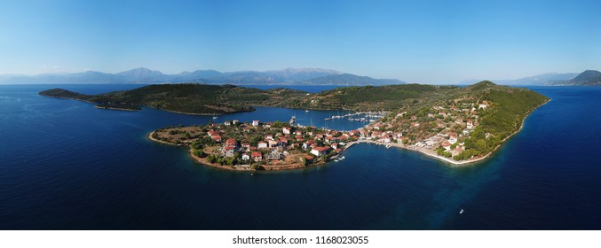 Aerial drone panoramic photo of Trizonia a small island in Corinthian Gulf and the only inhabited island among the islands of Corinthian gulf, Fokida, Greece