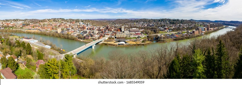 Aerial drone panoramic view of the downtown area of Morgantown  in West Virginia and the camput of the university.