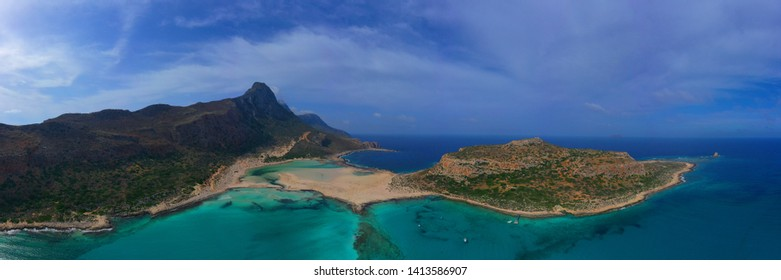 Aerial drone panoramic view of iconic azure turquoise Balos beach lagoon near Gramvousa island and pure white sand, North West Crete island, Greece