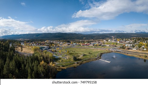 Aerial drone panoramic view of a small town, Logan Lake, in the interior British Columbia, Canada. Taken during a colorful Autumn day.