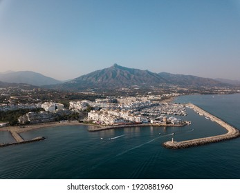 Aerial drone perspective of famous Puerto Banus - Banus Bay , situated in luxury and exclusive area of Marbella , Nueva Andalucía. Famous place on costa del sol for luxury, extravagance and night life