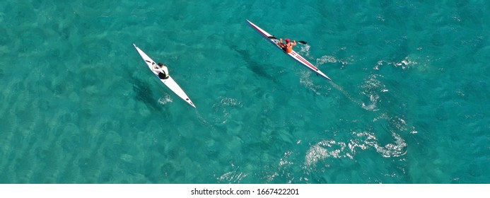 Aerial drone photo of athletes competing in sport canoe in tropical exotic bay with emerald clear sea