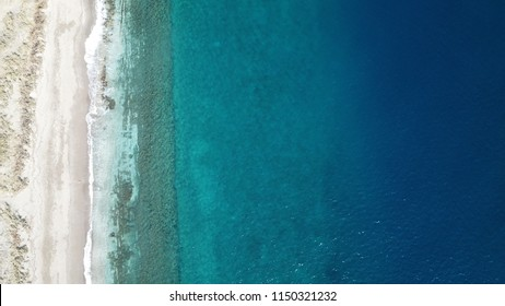 Aerial drone photo beach, reef and ocean