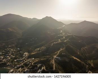 Aerial drone photo of beautiful cretan village at sunset