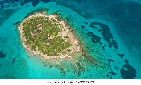 Aerial drone photo of beautiful paradise secluded island complex in gulf of of Petalioi or Petalion that form a blue lagoon with sandy turquoise beaches, South Evoia island near Marmari, Greece