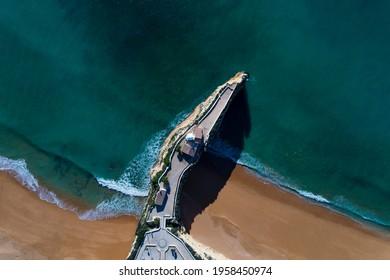 Aerial drone photo of the beautiful Praia da Senhora da Rocha (Senhora da Rocha Beach) with the white chapel on the roks, near Armacao de Pera, Algarve, Portugal