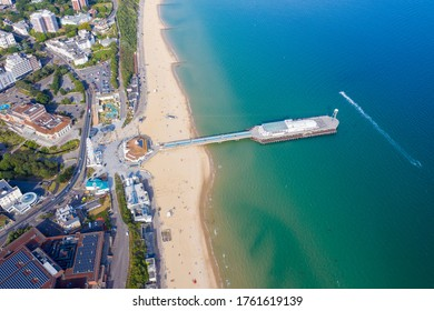 Aerial drone photo of the Bournemouth beach, Observation Wheel and Pier on a beautiful sunny summers day with lots of people relaxing and sunbathing on the British Dorset sandy beach and ocean