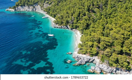 Aerial drone photo of breathtaking secluded turquoise beaches of Ftelia and Megalo Pefko in island of Skopelos, Sporades, Greece