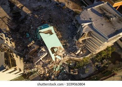 Aerial drone photo of a building under demolition rubble aftermath earthquake